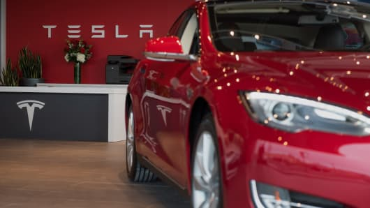 A Model S electric vehicle (EV) is displayed inside the show room at the Tesla Motors Inc. Gallery and Service Center in Paramus, New Jersey.