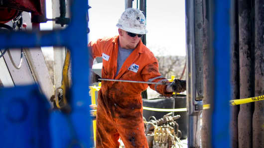 An operator for Baker Hughes conducts a wireline survey on a Chesapeake Energy natural gas rig in the North Texas Barnett Shale near Burleson, Texas.