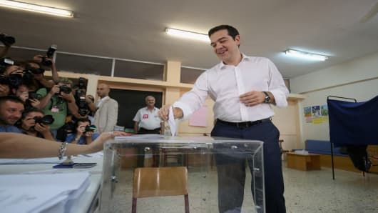 Greek Prime Minister Alexis Tsipras puts his referendum vote in the ballot box