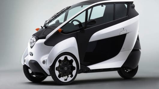 The electric i-Road is being piloted in Japan and France, but company hopes to introduce it more widely.