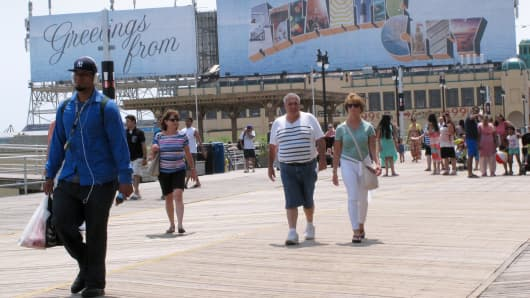 People on the boardwalk in Atlantic City, NJ.