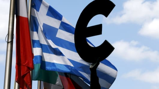 A Greek flag flies outside the European Parliament in Brussels.
