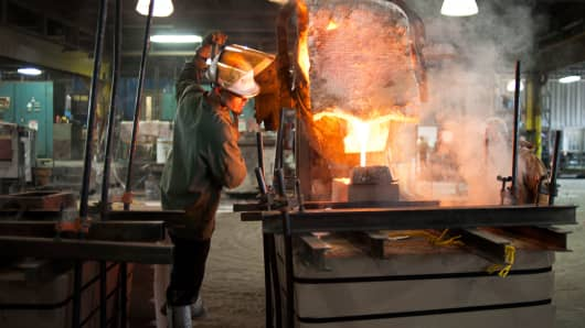 An employee works in the foundry area of Trumbull Metal Specialties in Niles, Ohio.