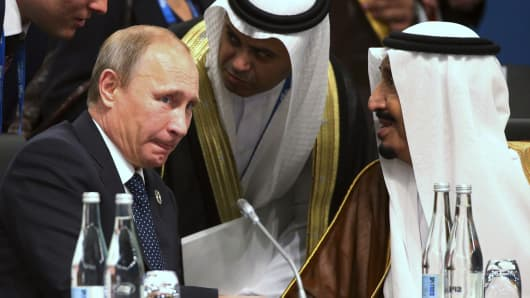 President of Russia Vladimir Putin and Crown Prince Salman bin Abdulaziz Al Saud of Saudi Arabia talk during a plenary session at the G20 leaders summit in Brisbane November 15, 2014.