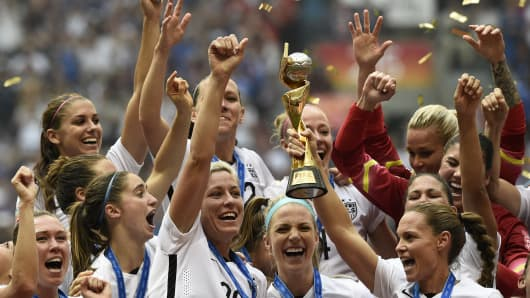 The U.S. team hold the trophy after winning the final match of the 2015 FIFA Women's World Cup