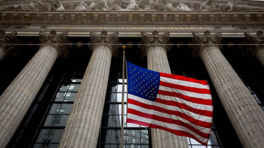 The American flag hangs outside the New York Stock Exchange