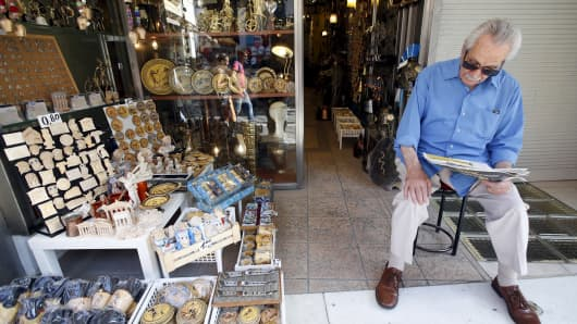 A vendor waits for customers at his shop in Athens, Greece, July 7, 2015.