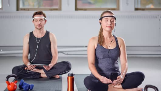 Man and woman using Muse Headbands