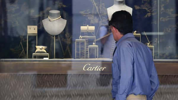A man browses jewellery in the Cartier store in upmarket Athens on July 9, 2015 in Athens, Greece.