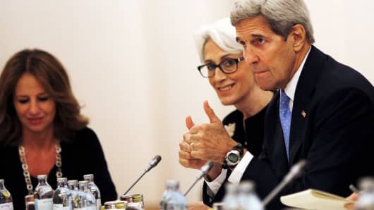 Secretary of State John Kerry and U.S. Under Secretary for Political Affairs Wendy Sherman (C) meet with foreign ministers during nuclear talks at a hotel in Vienna, July 10, 2015.