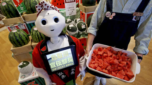 SoftBank's human-like robot named Pepper poses for pictures in its role as a PR manager of Tottori prefecture at the prefecture specialty store in Tokyo, July 1, 2015.