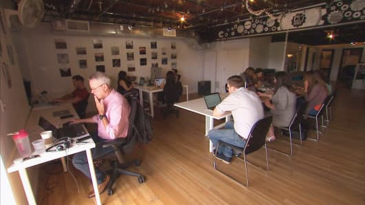 Members at work in the shared desks at coworking space, Cowerks, located in Asbury Park, NJ.