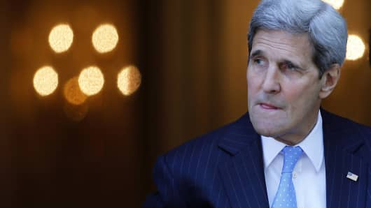 Secretary of State John Kerry leaves his hotel on the way to mass at the St. Stephen's Cathedral in Vienna, Austria July 12, 2015 where the Iran nuclear talks meetings are being held. World powers raced to clinch a landmark deal to prevent Iran acquiring a nuclear bomb, with a source close to the marathon talks saying an agreement was '98-percent' completed.