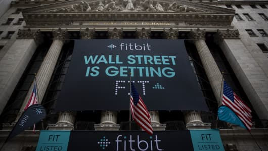 Fitbit banners decorate the exterior of the New York Stock Exchange during the IPO debut of the company on June 18, 2015, in New York City.