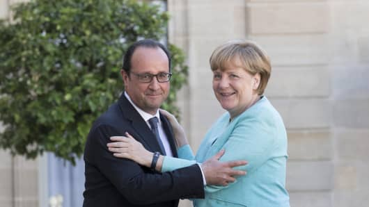 Francois Hollande, France's president, left, and Angela Merkel, Germany's chancellor.