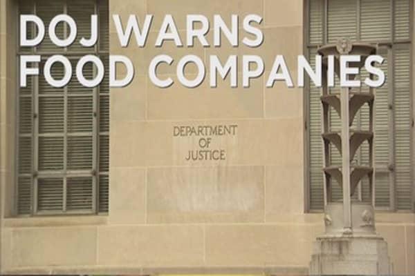 DOJ warns food companies