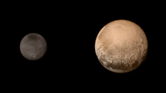 In this NASA handout, Pluto (R) and Charon are shown July 11, 2015, three days before the New Horizons spacecraft's flyby of the dwarf planet.