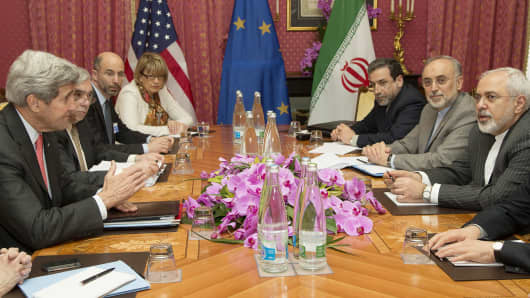 Secretary of State John Kerry in a negotiation session with Iran's Foreign Minister Javad Zarif over Iran's nuclear program in Lausanne on March 20, 2015, as European Union Political Director Helga Schmid looks on.