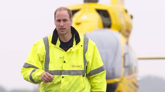 Prince William, The Duke of Cambridge as he begins his new job with the East Anglian Air Ambulance at Cambridge Airport on July 13, 2015 in Cambridge, England.