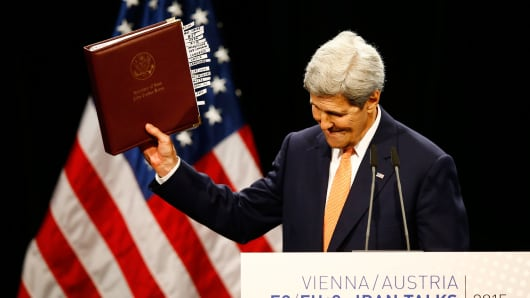 Secretary of State John Kerry reacts as he delivers a statement on the Iran talks deal at the Vienna International Center in Vienna, Austria July 14, 2015.