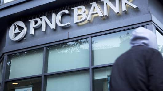A pedestrian walks past a PNC Bank branch in Washington, D.C.