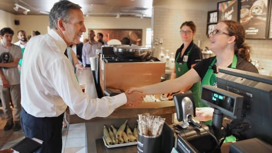 Starbucks CEO Howard Schultz greets employees and others at one of the company's locations in Charleston, S.C., June 19, 2015.