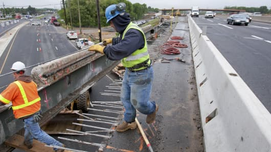 Workers extend an overpass on the New Jersey Turnpike in Bordentown.