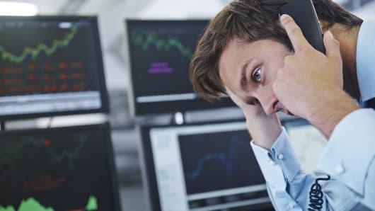 Worried stockbroker on phone