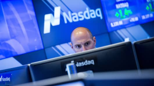 A man works at the NASDAQ exchange in New York.
