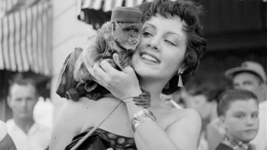 Actress Kathleen Case poses with a monkey during the opening day of Disneyland in Anaheim, California.