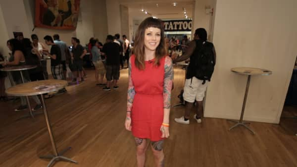 Tattoo model Megan Leahy shows off her body suit at the NYC Tattoo Convention in June.