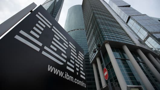 A sign for International Business Machines Corp. (IBM) stands outside offices at the Moscow International Business Center.