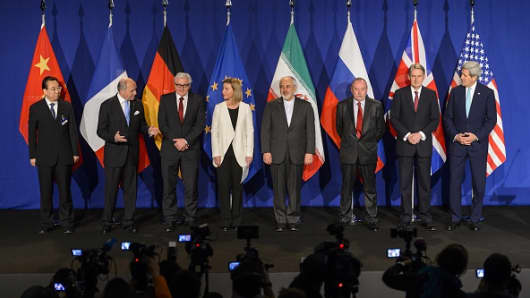 P5+1 and Iran representative pose prior to the announcement of an agreement on Iran nuclear talks on April 2, 2015 at the The Swiss Federal Institutes of Technology