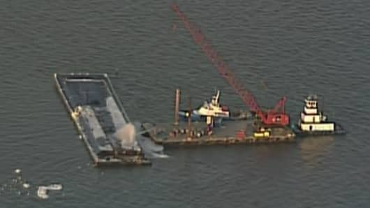 A Barge carrying 1 million gallons of Naphtha catches fire near Houston, Texas.