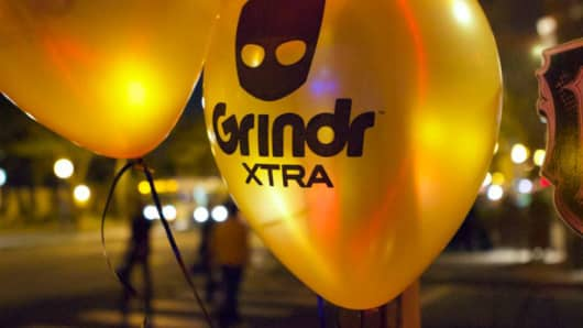 Grindr dating app signage on balloons