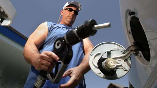 A customer fills his tank at a gas station in Wheeler Ridge, California.