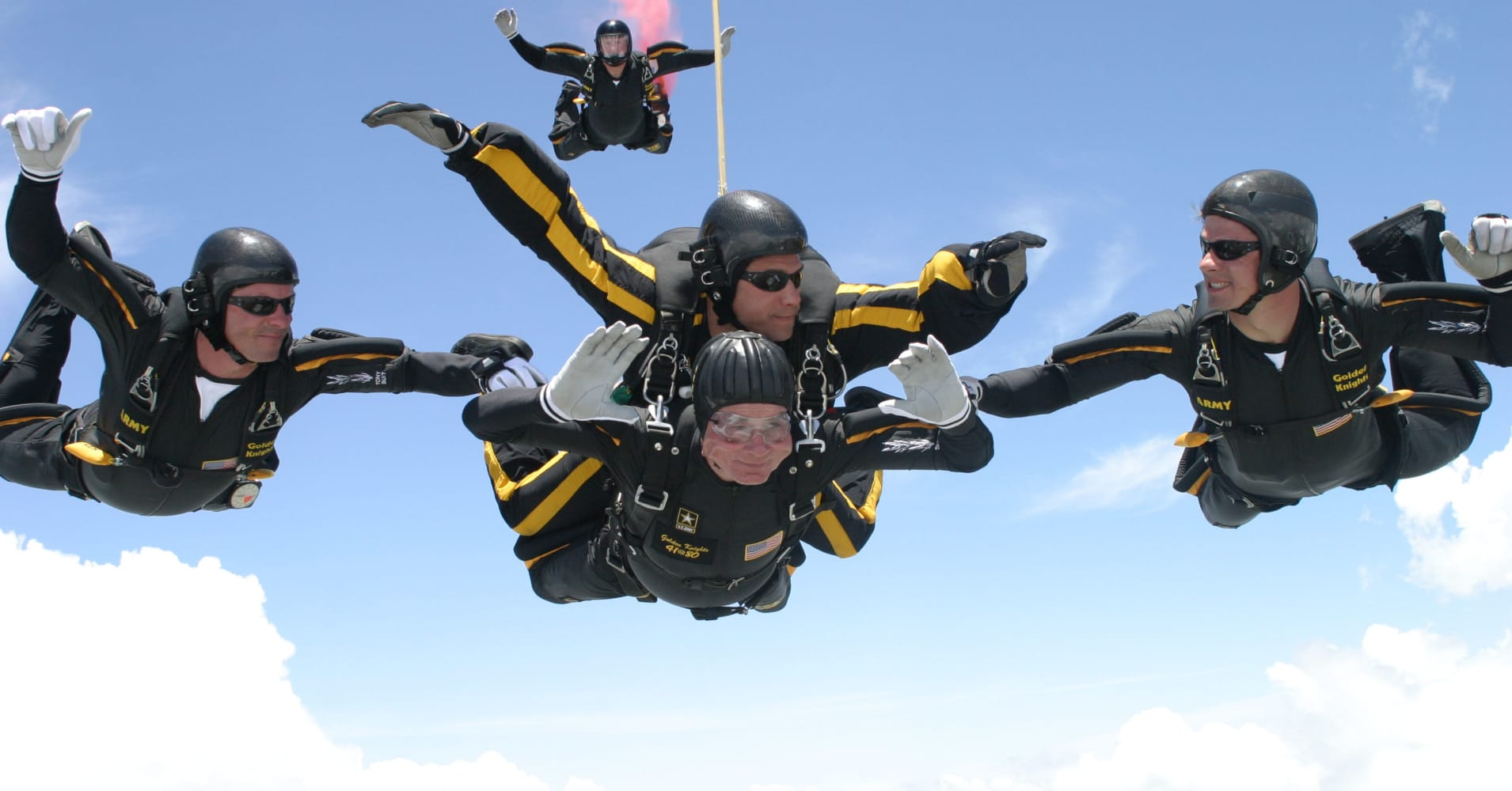 Celebrating his 80th birthday, Bush (C, bottom) skydives in tandem with Army Sgt. Bryan Schnell on June 13, 2004, over the Bush Presidential Library in College Station, Texas.