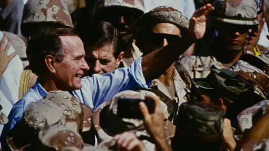 Bush celebrates Thanksgiving with the Marines in Saudi Arabia during the Gulf War, Nov. 22, 1990.