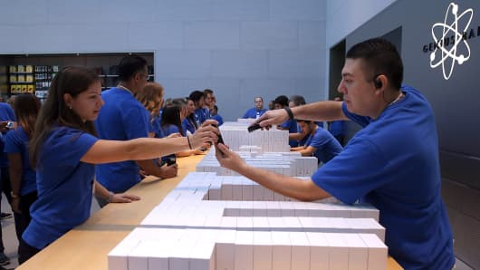Apple Store employees fill orders of the new iPhone 6 in Palo Alto, California.