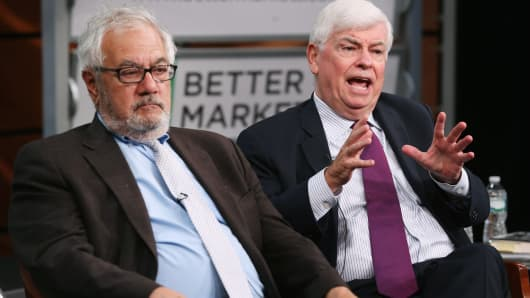 Former Rep. Barney Frank (D-MA) (L) and former Sen. Chris Dodd (D-CT) talk about their hallmark and namesake legislation, the Dodd-Frank reform law, on the fifth anniversary of the law at the Newseum July 20, 2015 in Washington.