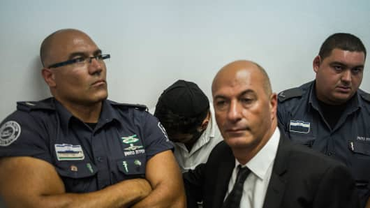 One of two Israeli men charged with the hacking of the JPMorgan Chase bank attends a court hearing, on July 22, 2015 in Jerusalem, Israel.