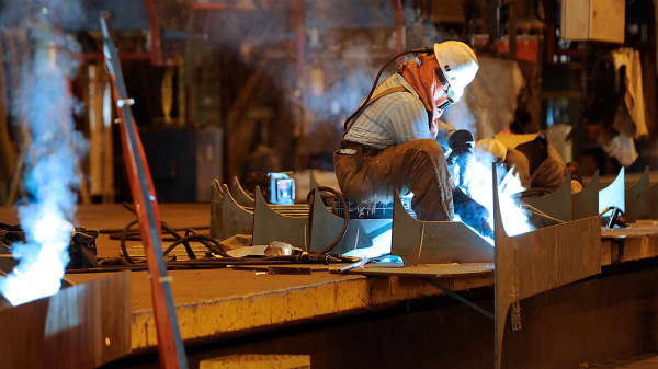 Welders work on a petroleum tanker at the Aker Philadelphia Shipyard in Philadelphia.