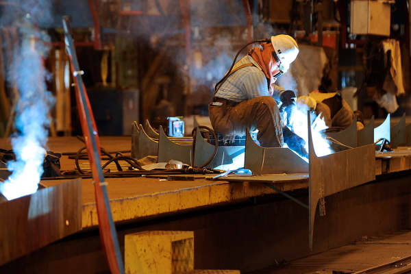 Welders work on a petroleum tanker at the Aker Philadelphia Shipyard in Philadelphia.