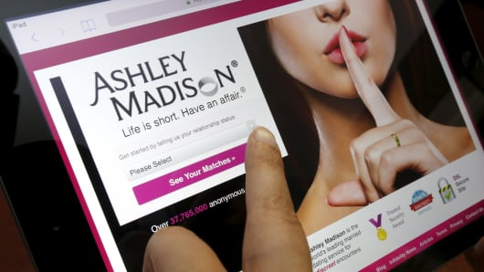 Homepage of the Ashley Madison website on an iPad.