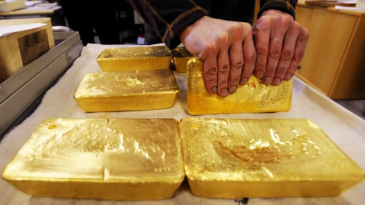 An Austrian worker handles ten kilogram 'raw' gold bars in Austrian gold bullion factory Oegussa in Vienna.