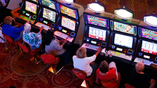 People play the slot machines at the Mohegan Sun in Uncasville, CT