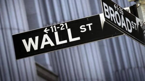 Wave of earnings flood Wall Street
