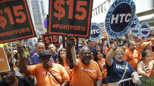 Activists cheer after the New York Wage Board endorsed a proposal to set a $15 minimum wage for workers at fast-food chains, July 22, 2015.