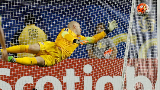 Goalie Brad Guzan of the United States tries unsuccessfully to stop a shot on goal by Darren Mattocks of Jamaica during the first half of the 2015 CONCACAF semifinal match at Atlanta's Georgia Dome on July 22, 2015.