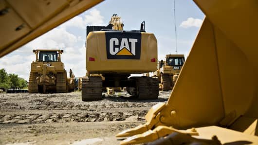 A Caterpillar excavator sits outside the Altorfer Cat dealership in East Peoria, Illinois.